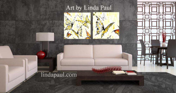 grey living room with white yellow black and red art