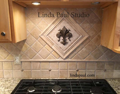 fleur de lis mosaic tile and metal medallion