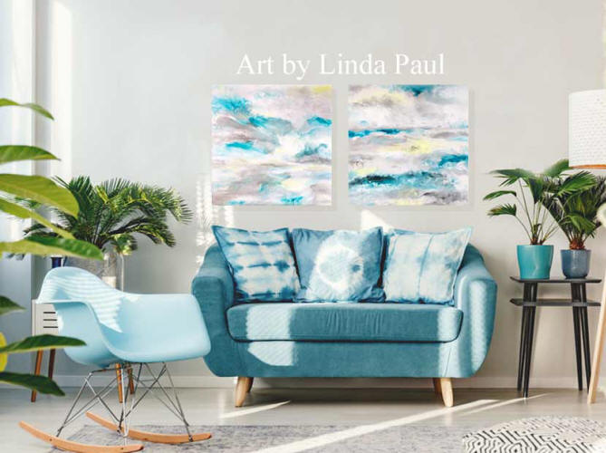 living room with blue sofa and abstract ocean art