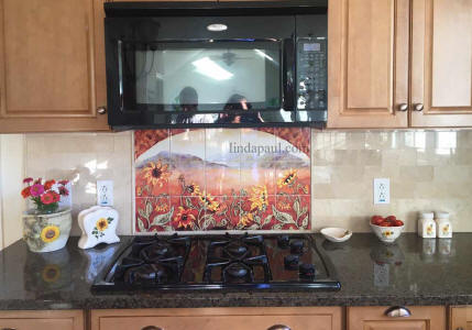tile mural between stove and microwave