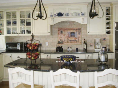 french country white kitchen with black granite island