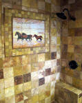 wild horses mural in bathroom shower stall