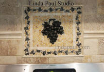 grape and vine stone and metal backsplash mosaic