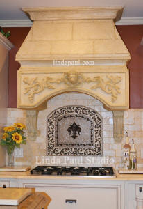 custom kitchen with backsplash medallion and faux stone hood